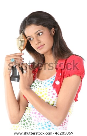 Indian teenage girl with her gold trophy