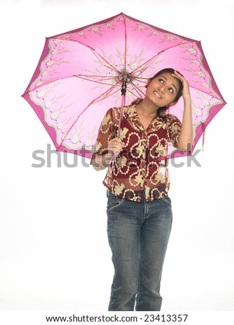 Indian teenage under the umbrella with one hand on her hand - stock photo