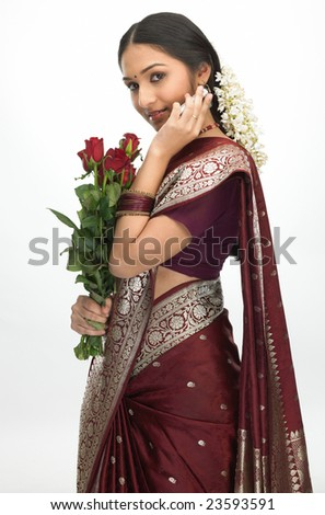 Indian teenage with bunch of roses - stock photo