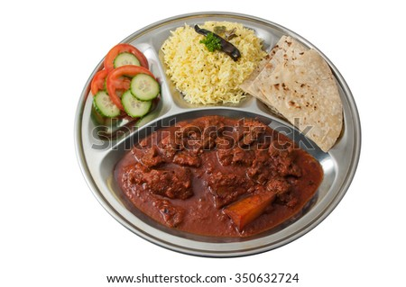 Indian thali - meal served on metal plate - isolated on white background