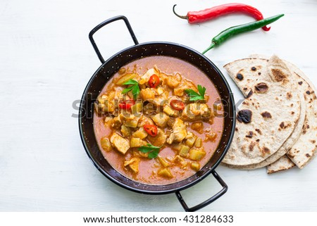 Indian tikka masala chicken and naan flat bread