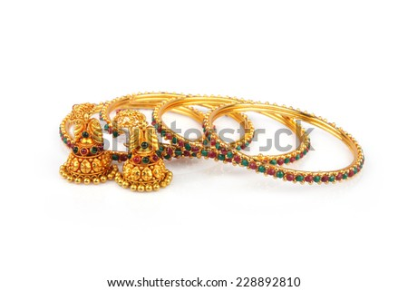 Indian Traditional Gold Bangle with Earrings - stock photo