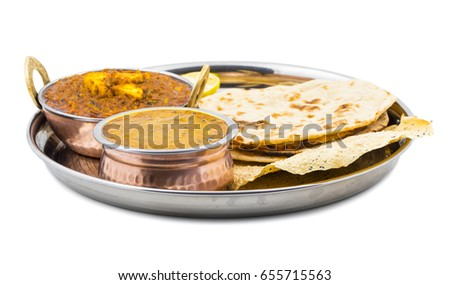 Indian Traditional Thali Food Dal Makhani Served with Chapati, Papad, Kadai Paneer or Lemon Also Know as Dal Makhni or Daal Makhani is a Popular Dish From Punjab. isolated on White Background
