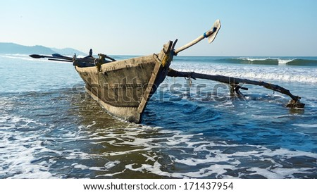 Indian traditional wooden fishing boat. GOA - stock photo