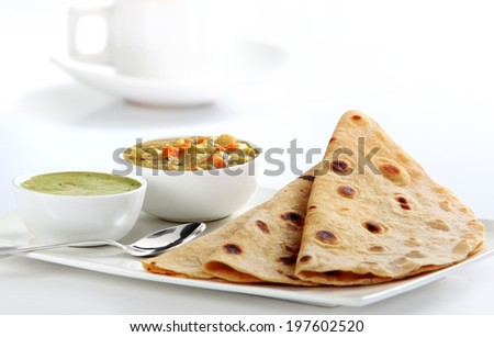 Indian Vegetable Curry and Chapati - Homemade chapati (Indian bread) served with delicious Indian vegetable curry.  - stock photo
