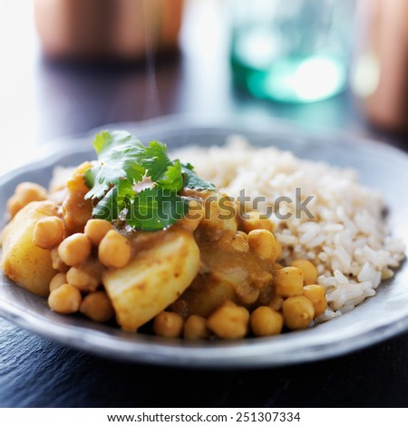 indian vegetarian curry with potatoes, chickpeas and lentils - stock photo