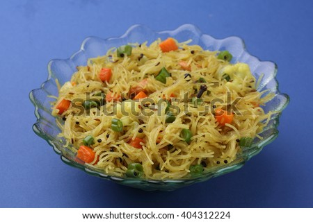 indian Vegetarian food called semiya upma prepared from vermicelli.  - stock photo