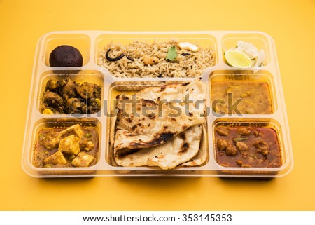 Indian vegetarian thali or food platter for parcel or for home delivery