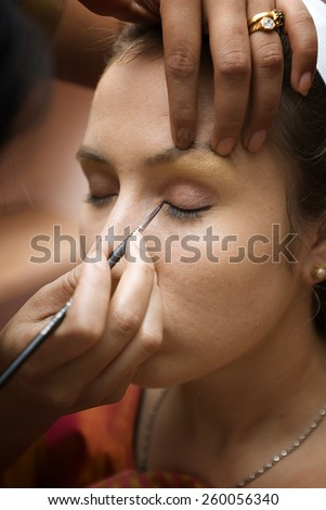 Indian wedding - preparation of bride - stock photo