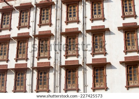 Indian windows on the facade of the building in Pushkar, Rajasthan, India
