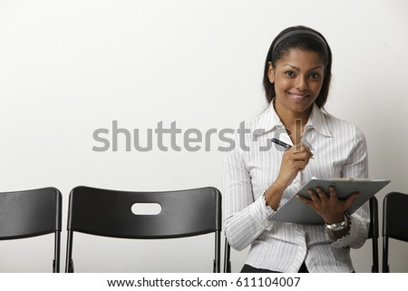 Indian woman fills our form in waiting room
