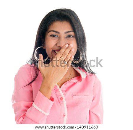 Indian woman giggles covering her mouth with hand, portrait of beautiful Asian female model isolated on white - stock photo