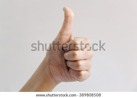 Indian woman hand gesture, thumbs up