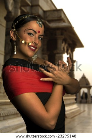 indian woman in front of temple - stock photo