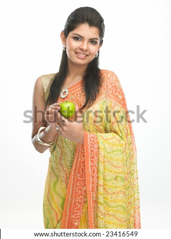 Indian woman in sari with green apple - stock photo
