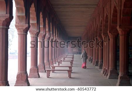 Indian woman in Taj Mahal gardens - stock photo