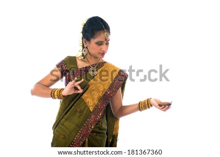 indian woman in traditional clothes with lamp - stock photo