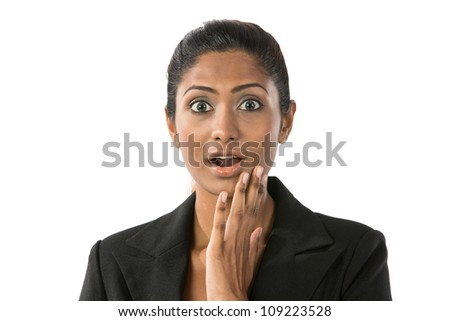 Indian woman looking shocked and surprised. Isolated on white - stock photo
