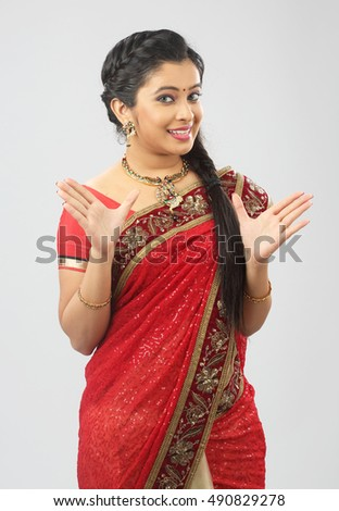 Indian woman showing gesturing on white background.