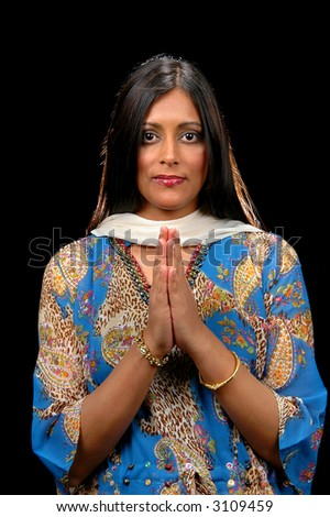 Indian Woman showing respect and gratitude isolated over a black background.