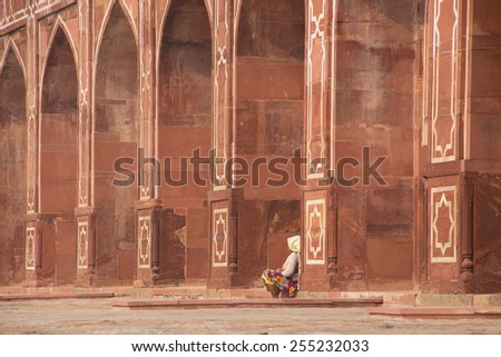 Indian woman sitting outside Humayun's Tomb, Delhi, India. It was the first garden-tomb on the Indian subcontinent.