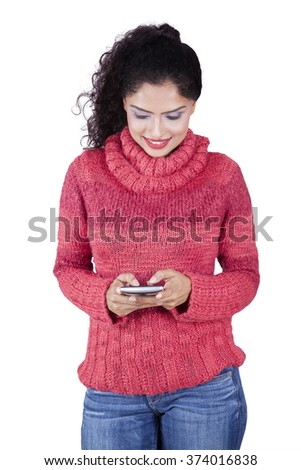 Indian woman texting message with smartphone, isolated on white background - stock photo