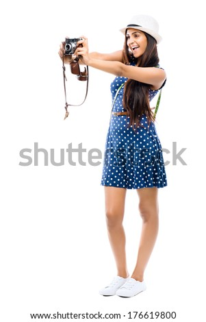 Indian woman tourist photographer hipster retro camera full length portrait - stock photo