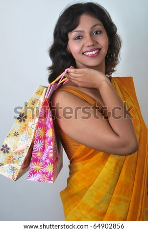 Indian woman with shopping bags - stock photo