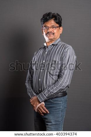 Indian 55 year old man portrait, Mumbai, Maharashtra, India, Southeast Asia - stock photo