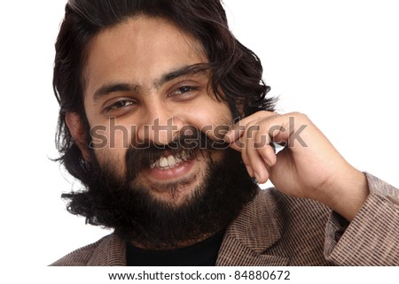 Indian young bearded businessman posing to the camera.