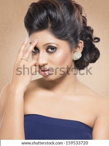 Indian young beautiful girl looking at the camera. - stock photo