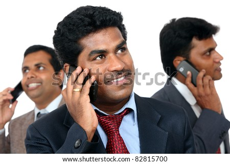 Indian young business peoples talking in mobile phone. - stock photo