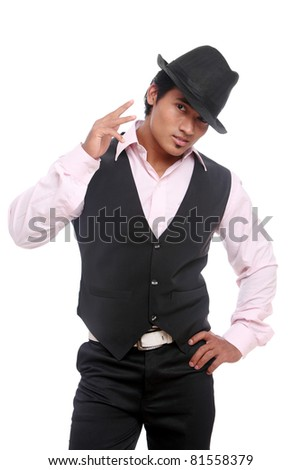 Indian young businessman posing with hat isolated on white.