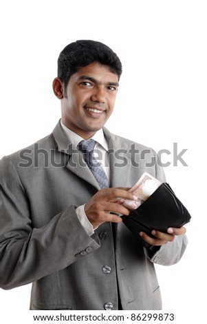 Indian young businessman with money. - stock photo