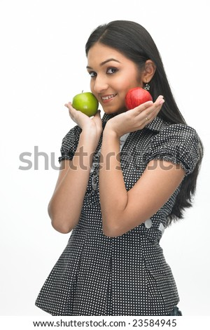 Indian young girl with red and green apples - stock photo