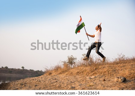 indian young man holding and running with  indian flag, conceptual image for republic day or independence day, handsome man running with indian flag, man running with indian flag, indian flag waving - stock photo