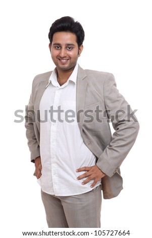 Indian young man standing on white background.