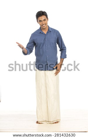 Indian young man welcoming in traditional dress on white background. - stock photo
