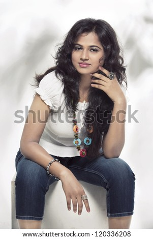 Indian young petty girl in modern dress. - stock photo