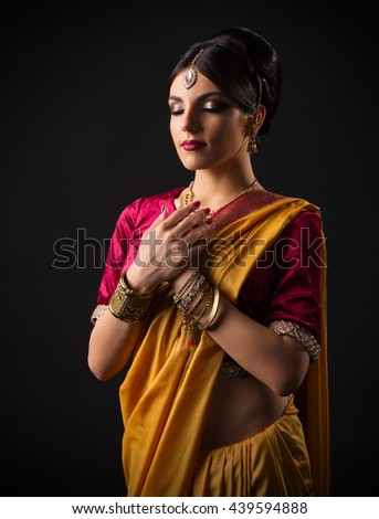 Indian young woman on grey - stock photo