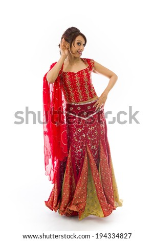 Indian young woman with hand to ear listening isolated over white background