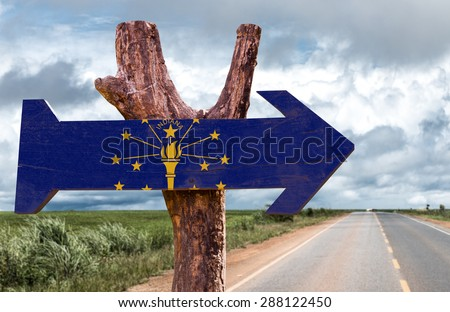 Indiana Flag wooden sign with road background - stock photo