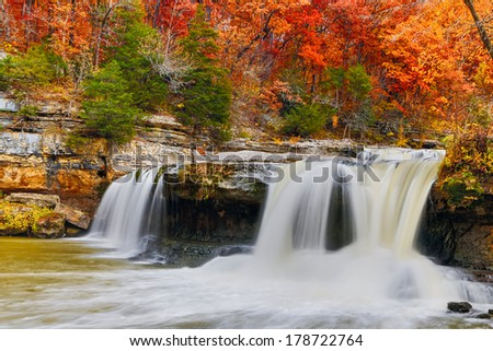 Indiana's Upper Cataract Falls is surrounded by glorious fall foliage color. - stock photo