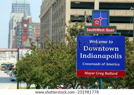 INDIANAPOLIS - AUGUST 2: A welcome sign in downtown Indianapolis, Indiana on August 2, 2014. Indianapolis is the capital and largest city of the US State of Indiana. - stock photo