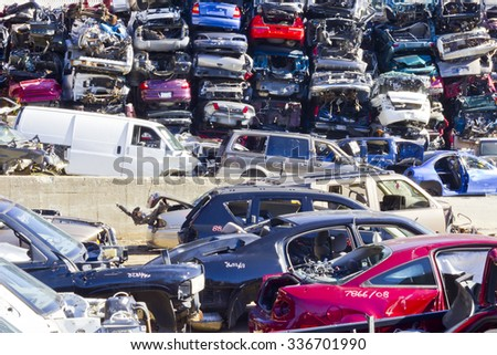 Indianapolis - Circa November 2015 - A Pile of Stacked Junk Cars - Discarded Junk Cars Piled Up After Crushing