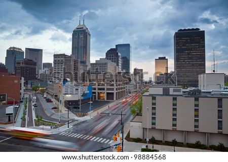Indianapolis. Image of the Indianapolis skyline with busy traffic and dramatic sky. - stock photo