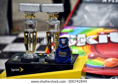 Indianapolis, IN - Jul 26, 2015: Kyle Busch (18) celebrates after winning the Crown Royal Presents the Jeff Kyle 400 at the Brickyard at Indianapolis Motor Speedway in Indianapolis, IN. - stock photo