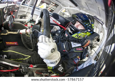 INDIANAPOLIS, IN - JULY 24:  Carl Edwards straps into his Aflac Ford before a practice session for the Brickyard 400 race at the Indianapolis Motor Speedway on July 24, 2010 in Indianapolis, IN. - stock photo