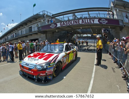 INDIANAPOLIS, IN - JULY 24:  Greg Biffle brings his 3M Ford Fusion back into the garage area for the Brickyard 400 race at the Indianapolis Motor Speedway on July 24, 2010 in Indianapolis, IN. - stock photo