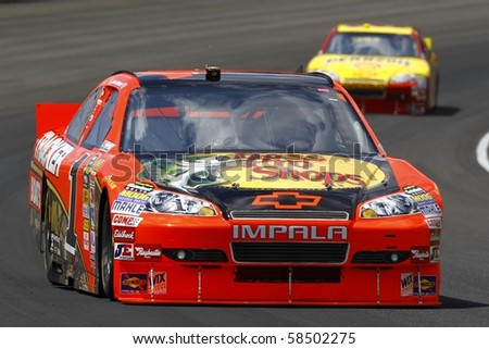 INDIANAPOLIS, IN - JULY 25: Jaime McMurray (1) leads Kevin Harvick (29)during race action for the Brickyard 400 race at the Indianapolis Motor Speedway on July 25, 2010 in Indianapolis, IN. - stock photo